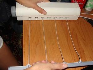 Особенности приспособлений для сушки одежды и белья на балконе